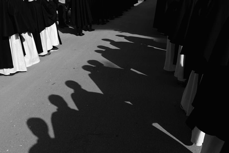Shadows of Altar boys in Buseto, Sicily