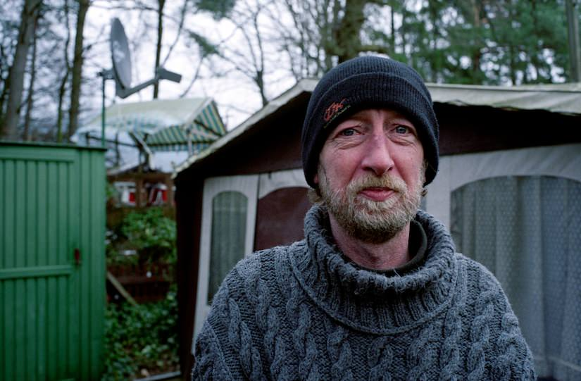 Portrait of a Dauercamper outside of his trailer, January 2007.