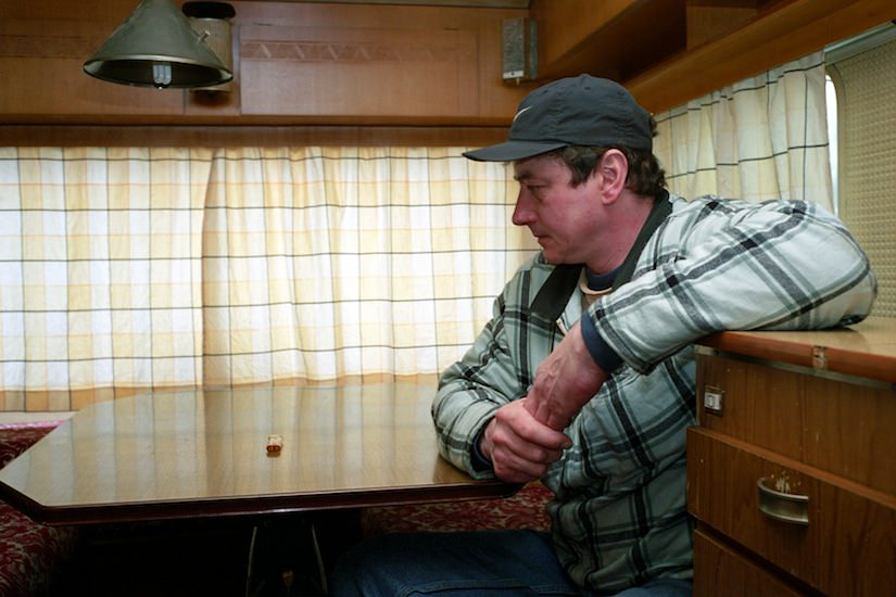Portrait of Wayne inside of his trailer contemplating life