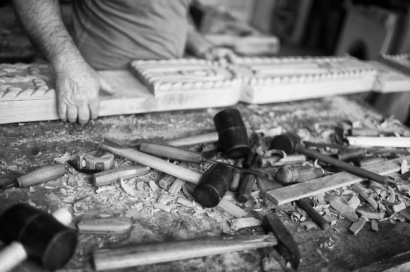 A wood carver and his traditional tools in Maramures,Romania