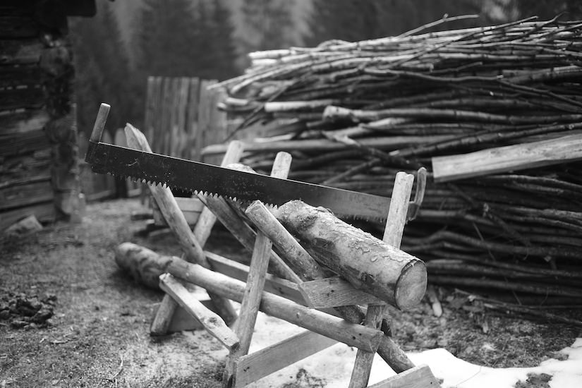 a traditional Romanian saw and wood pile