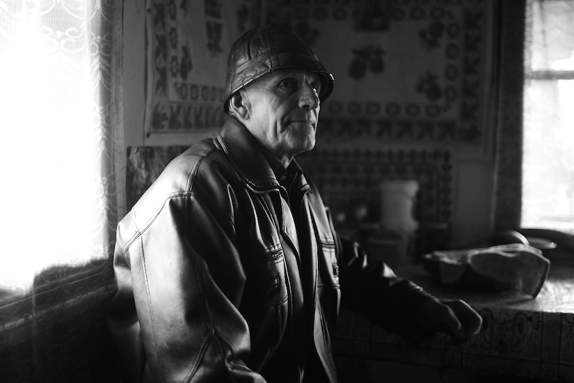 Portrait of a Romanian gentleman inside of his cabin in the mountains of Moldovita