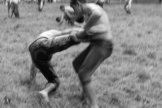 A photo of a wrestler fighting his competitor
